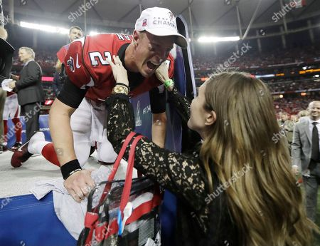 Atlanta Falcons quarterback Matt Ryan embraces his wife Sarah Marshall after the NFL football NFC championship game, in Atlanta. The Falcons won 44-21 to advance to Super Bowl LI