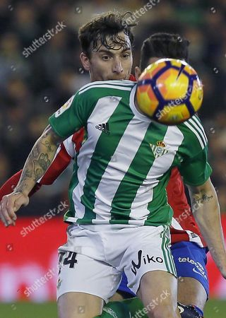 Real Betis' striker Ruben Castro (R) in action against Venezuelan defender Fernando Amorebieta (L) of Sporting Gijon during their Spanish Primera Division soccer match played at the Benito Villamarin stadium in Seville, southern Spain, on 22 January 2017.