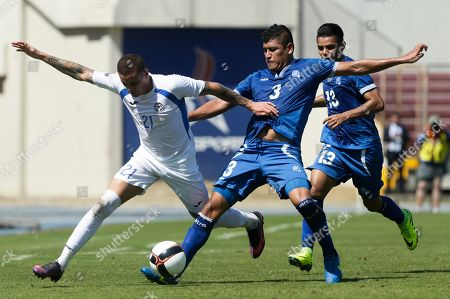 Jaime Moreno, Roberto Dominguez, Alexander Larin, right Nicaragua's Jaime Moreno, left, El Salvador's Roberto Dominguez, center, and El Salvador's Alexander Larin, right, fight for the ball during a Central America Cup soccer match in Panama City