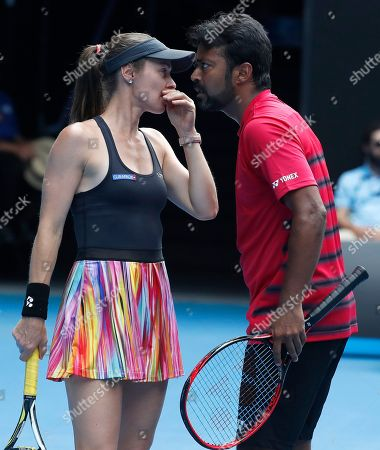 Switzerland's Martina Hingis, left, and partner India's Leander Paes talk during their mixed double match against Croatia's Nikola Mektic and Brian Baker of the United States at the Australian Open tennis championships in Melbourne, Australia