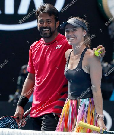 Switzerland's Martina Hingis, right, and partner India's Leander Paes celebrate their mixed doubles win over Croatia's Nikola Mektic and Brian Baker of the United States at the Australian Open tennis championships in Melbourne, Australia