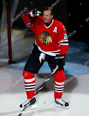 Stock Image of Former Chicago Blackhawks player Jeremy Roenick acknowledges the crowd after being honored before an NHL hockey game between the Vancouver Canucks and the Blackhawks, in Chicago