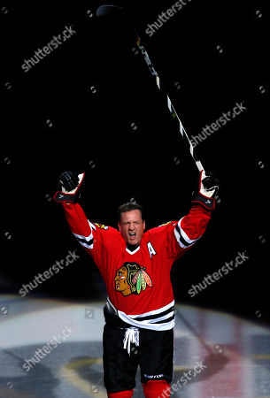 Stock Picture of Former Chicago Blackhawks player Jeremy Roenick acknowledges the crowd after being honored before an NHL hockey game between the Vancouver Canucks and the Blackhawks, in Chicago