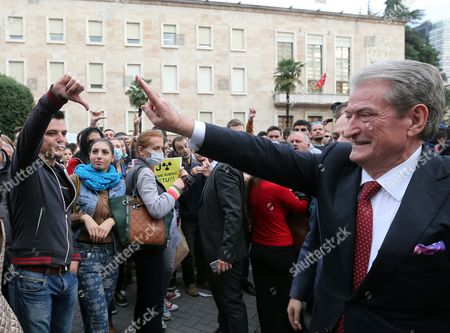 Former Albanian Prime Minister Sali Berisha (r) Gestures As Students Protest Against Chemical Weapons in Front of the Government Building in Tirana Albania 14 November 2013 Albania's Conservative Opposition Said It Would Push For a Referendum on a Us Request to Destroy Syria's Chemical Weapons Arsenal on Its Territory Reports State That Albania Has Emerged As a Possible Location For the Destruction of Syria's Chemical Weapons Arsenal Under a September 2013 Un Security Council Resolution Norway Has Rejected a Us Request to Destroy the Arms Moscow's Kommersant Newspaper Quoted Russian Diplomats As Saying That Albania was Emerging As a Possibility Russia is Ready to Contribute About 2 Million Us Dollars For the Planned Chemical Weapons Destruction the Report Said Albania Tirana