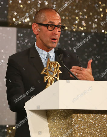 Us Phil Gurin of the Gurin Company 405 Productions Raquel Productions Warner Horizon For the Cw (u S ) Makers of the Us Game Show ' Oh Sit' Reacts After Receiving the Award in the Game Show Categorie During the Award Ceremony of the 52st Festival Rose D'or Or Golden Rose Global Entertainment Television Festival in Brussels Belgium 30 May 2013 Belgium Brussels