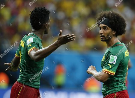 Benjamin Moukandjo of Cameroon (l) and Benoit Assou-ekotto of Cameroon Argue During the Fifa World Cup 2014 Group a Preliminary Round Match Between Cameroon and Croatia at the Arena Amazonia in Manaus Brazil 18 June 2014 (restrictions Apply: Editorial Use Only not Used in Association with Any Commercial Entity - Images Must not Be Used in Any Form of Alert Service Or Push Service of Any Kind Including Via Mobile Alert Services Downloads to Mobile Devices Or Mms Messaging - Images Must Appear As Still Images and Must not Emulate Match Action Video Footage - No Alteration is Made to and No Text Or Image is Superimposed Over Any Published Image Which: (a) Intentionally Obscures Or Removes a Sponsor Identification Image; Or (b) Adds Or Overlays the Commercial Identification of Any Third Party Which is not Officially Associated with the Fifa World Cup) Brazil Manaus