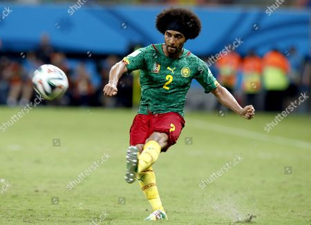 Benoit Assou-ekotto of Cameroon in Action During the Fifa World Cup 2014 Group a Preliminary Round Match Between Cameroon and Croatia at the Arena Amazonia in Manaus Brazil 18 June 2014 (restrictions Apply: Editorial Use Only not Used in Association with Any Commercial Entity - Images Must not Be Used in Any Form of Alert Service Or Push Service of Any Kind Including Via Mobile Alert Services Downloads to Mobile Devices Or Mms Messaging - Images Must Appear As Still Images and Must not Emulate Match Action Video Footage - No Alteration is Made to and No Text Or Image is Superimposed Over Any Published Image Which: (a) Intentionally Obscures Or Removes a Sponsor Identification Image; Or (b) Adds Or Overlays the Commercial Identification of Any Third Party Which is not Officially Associated with the Fifa World Cup) Brazil Manaus