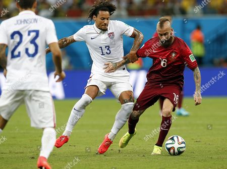 Jermaine Jones of the Usa (l) and Raul Meireles of Portugal in Action During the Fifa World Cup 2014 Group G Preliminary Round Match Between the Usa and Portugal at the Arena Amazonia in Manaus Brazil 22 June 2014 (restrictions Apply: Editorial Use Only not Used in Association with Any Commercial Entity - Images Must not Be Used in Any Form of Alert Service Or Push Service of Any Kind Including Via Mobile Alert Services Downloads to Mobile Devices Or Mms Messaging - Images Must Appear As Still Images and Must not Emulate Match Action Video Footage - No Alteration is Made to and No Text Or Image is Superimposed Over Any Published Image Which: (a) Intentionally Obscures Or Removes a Sponsor Identification Image; Or (b) Adds Or Overlays the Commercial Identification of Any Third Party Which is not Officially Associated with the Fifa World Cup) Brazil Manaus