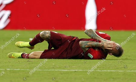 Raul Meireles of Portugal Lies on the Pitch During the Fifa World Cup 2014 Group G Preliminary Round Match Between the Usa and Portugal at the Arena Amazonia in Manaus Brazil 22 June 2014 (restrictions Apply: Editorial Use Only not Used in Association with Any Commercial Entity - Images Must not Be Used in Any Form of Alert Service Or Push Service of Any Kind Including Via Mobile Alert Services Downloads to Mobile Devices Or Mms Messaging - Images Must Appear As Still Images and Must not Emulate Match Action Video Footage - No Alteration is Made to and No Text Or Image is Superimposed Over Any Published Image Which: (a) Intentionally Obscures Or Removes a Sponsor Identification Image; Or (b) Adds Or Overlays the Commercial Identification of Any Third Party Which is not Officially Associated with the Fifa World Cup) Brazil Manaus