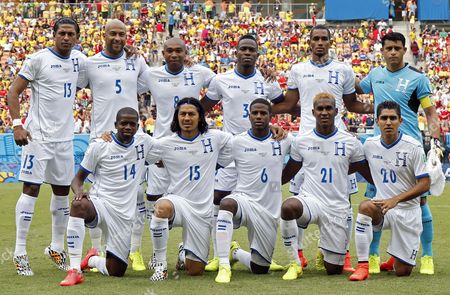 Stock Picture of Honduras's Starting Eleven (top L-r) Carlo Costly Victor Bernardez Wilson Palacios Maynor Figueroa Jerry Bengtson Goalkeeper Noel Valladares (bottom L-r) Boniek Garcia Roger Espinoza Juan Carlos Garcia Brayan Beckeles and Jorge Claros Line Up For the Group Photo Prior the Fifa World Cup 2014 Group E Preliminary Round Match Between Honduras and Switzerland at the Arena Amazonia in Manaus Brazil 25 June 2014 (restrictions Apply: Editorial Use Only not Used in Association with Any Commercial Entity - Images Must not Be Used in Any Form of Alert Service Or Push Service of Any Kind Including Via Mobile Alert Services Downloads to Mobile Devices Or Mms Messaging - Images Must Appear As Still Images and Must not Emulate Match Action Video Footage - No Alteration is Made to and No Text Or Image is Superimposed Over Any Published Image Which: (a) Intentionally Obscures Or Removes a Sponsor Identification Image; Or (b) Adds Or Overlays the Commercial Identification of Any Third Party Which is not Officially Associated with the Fifa World Cup) Brazil Manaus