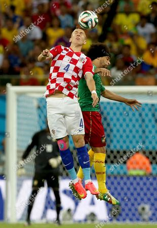 Ivan Perisic (l) of Croatia Vies with Benoit Assou-ekotto of Cameroon During the Fifa World Cup 2014 Group a Preliminary Round Match Between Cameroon and Croatia at the Arena Amazonia in Manaus Brazil 18 June 2014 (restrictions Apply: Editorial Use Only not Used in Association with Any Commercial Entity - Images Must not Be Used in Any Form of Alert Service Or Push Service of Any Kind Including Via Mobile Alert Services Downloads to Mobile Devices Or Mms Messaging - Images Must Appear As Still Images and Must not Emulate Match Action Video Footage - No Alteration is Made to and No Text Or Image is Superimposed Over Any Published Image Which: (a) Intentionally Obscures Or Removes a Sponsor Identification Image; Or (b) Adds Or Overlays the Commercial Identification of Any Third Party Which is not Officially Associated with the Fifa World Cup) Brazil Manaus