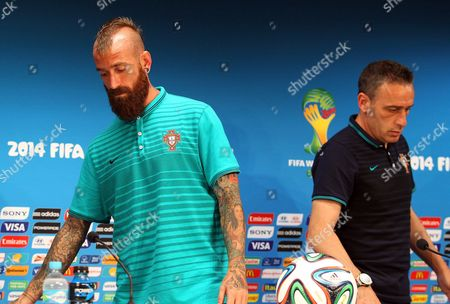 Portuguese National Soccer Team Head Coach Paulo Bento (r) and Raul Meireles (l) Arrive For a Press Conference at the Arena Amazonia in Manaus Brazil 21 June 2014 Portugal Will Face the Usa in the Fifa World Cup 2014 Group G Preliminary Round Match in Manaus on 22 June 2014 (restrictions Apply: Editorial Use Only not Used in Association with Any Commercial Entity - Images Must not Be Used in Any Form of Alert Service Or Push Service of Any Kind Including Via Mobile Alert Services Downloads to Mobile Devices Or Mms Messaging - Images Must Appear As Still Images and Must not Emulate Match Action Video Footage - No Alteration is Made to and No Text Or Image is Superimposed Over Any Published Image Which: (a) Intentionally Obscures Or Removes a Sponsor Identification Image; Or (b) Adds Or Overlays the Commercial Identification of Any Third Party Which is not Officially Associated with the Fifa World Cup) Brazil Manaus