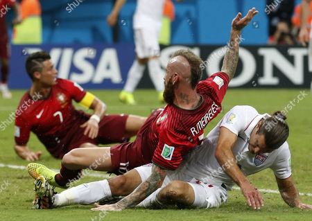 Raul Meireles (c) of Portugal in Action with Graham Zusi (r) of the Usa During the Fifa World Cup 2014 Group G Preliminary Round Match Between the Usa and Portugal at the Arena Amazonia in Manaus Brazil 22 June 2014 (restrictions Apply: Editorial Use Only not Used in Association with Any Commercial Entity - Images Must not Be Used in Any Form of Alert Service Or Push Service of Any Kind Including Via Mobile Alert Services Downloads to Mobile Devices Or Mms Messaging - Images Must Appear As Still Images and Must not Emulate Match Action Video Footage - No Alteration is Made to and No Text Or Image is Superimposed Over Any Published Image Which: (a) Intentionally Obscures Or Removes a Sponsor Identification Image; Or (b) Adds Or Overlays the Commercial Identification of Any Third Party Which is not Officially Associated with the Fifa World Cup) Brazil Manaus