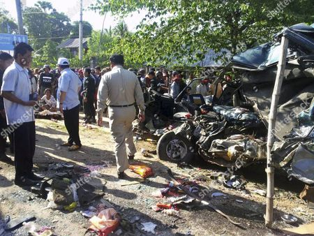 Members of the Cambodian Police Inspect the Site of a Road Crash at an Industrial Zone in Kompong Ro District Eastern Svay Rieng Province Cambodia 19 May 2015 a Group of Garment Workers was Killed in Cambodia when the Van Carrying Them to Their Factory Crashed Into a Tourist Bus Early 19 May Media Reported the Collision Occurred Around 7 Am (0000 Gmt) in the District of Kompong Ro Media Reported Citing Local Police Reports Varied About the Number of Dead Local Media Reported a Death Toll of Between 16 and 21 People While Other Sources Gave a Lower Toll a Rights Group Said the Workers Were Under the Responsibility of Their Employers Under Cambodian Law As They Were on Their Commute to Work Many of the Fatalities Were Women Said Dave Welsh Country Director For the Us-based Labor Rights Group Solidarity Center Cambodia Kompong Ro