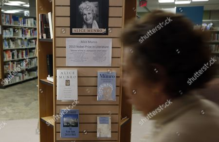A Woman Walks Past a Display of Books by Canadian Author Alice Munro at the Ottawa Public Library in Ottawa Ontario Canada 10 October 2013 82-year-old Canadian Author Alice Munro Has Been Awarded the 2013 Nobel Prize For Literature Canada Ottawa