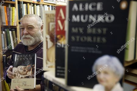 Grant Purdy Owner of the Book Gallery Bookstore Holds a Book by Canadian Writer Alice Munro 'The Love of a Good Woman: Stories' at His Store in Carleton Place Ontario Canada 10 October 2013 82-year-old Canadian Author Alice Munro Has Been Awarded the 2013 Nobel Prize For Literature Canada Ottawa