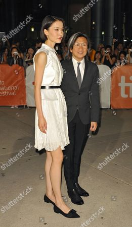 Chinese Actress and Cast Member Du Juan (l) and Chinese Director Peter Ho-sun Chan Arrive For the Screening of 'American Dreams in China' During the 38th Annual Toronto Film Festival in Toronto Canada 10 September 2013 the Festival Runs Until 15 September Canada Toronto