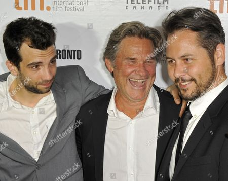 Cast Members Canadian Actor Jay Baruchel (l) and Us Actor Kurt Russell (c) Pose with Canadian Director Jonathan Sobol Before the Screening of 'The Art of the Steal' During the 38th Annual Toronto Film Festival in Toronto Canada 11 September 2013 the Festival Runs Until 15 September Canada Toronto