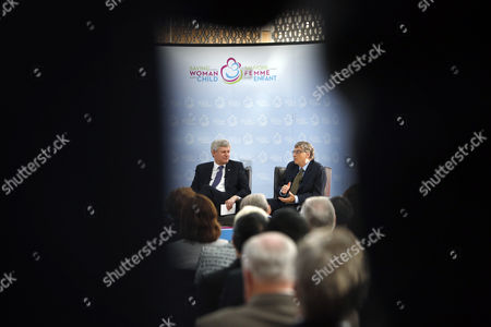 Canada's Prime Minister Stephen Harper Left Sits Alongside Microsoft Co-founder and Philanthropist Bill Gates at the Delegation of the Ismaili Imamat in Ottawa Canada on 25 February 2015 Gates Met with Harper to Discuss Global Efforts to Improve the Health of Mothers and Children in Low-income Countries Canada Ottawa