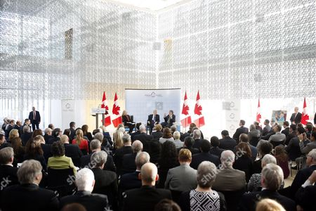 Canada's Prime Minister Stephen Harper (c) Talks on Stage with Microsoft Co-founder and Philanthropist Bill Gates Right at the Delegation of the Ismaili Imamat in Ottawa Canada on 25 February 2015 Gates Met with Harper to Discuss Global Efforts to Improve the Health of Mothers and Children in Low-income Countries Canada Ottawa