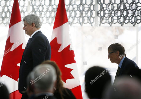 Canada's Prime Minister Stephen Harper Left Walks on Stage with Microsoft Co-founder and Philanthropist Bill Gates at the Delegation of the Ismaili Imamat in Ottawa Canada on 25 February 2015 Gates Met with Harper to Discuss Global Efforts to Improve the Health of Mothers and Children in Low-income Countries Canada Ottawa