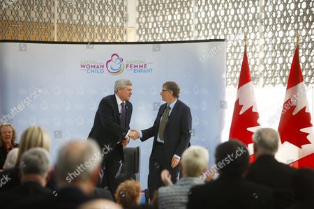 Canada's Prime Minister Stephen Harper Left Shakes Hands with Microsoft Co-founder and Philanthropist Bill Gates at the Delegation of the Ismaili Imamat in Ottawa Canada on 25 February 2015 Gates Met with Harper to Discuss Global Efforts to Improve the Health of Mothers and Children in Low-income Countries Canada Ottawa