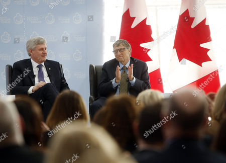 Canada's Prime Minister Stephen Harper Middle Talks on Stage with Microsoft Co-founder and Philanthropist Bill Gates Right at the Delegation of the Ismaili Imamat in Ottawa Canada on 25 February 2015 Gates Met with Harper to Discuss Global Efforts to Improve the Health of Mothers and Children in Low-income Countries Canada Ottawa
