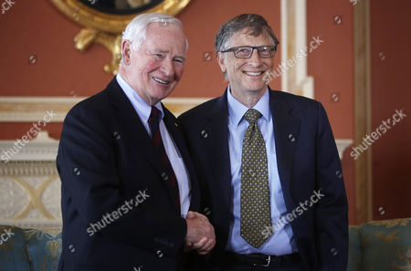 Microsoft Co-founder and Philanthropist Bill Gates (r) Shakes Hands with Canada's Governor General David Johnston at Rideau Hall in Ottawa Canada 25 February 2015 Gates is in Ottawa to Meet with Prime Minister Stephen Harper to Discuss Global Efforts to Improve the Health of Mothers and Children in Low-income Countries Canada Ottawa