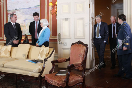Microsoft Co-founder and Philanthropist Bill Gates (3-r) Enters a Room Alongside Canada's Governor General David Johnston at Rideau Hall in Ottawa Canada 25 February 2015 Gates is in Ottawa to Meet with Prime Minister Stephen Harper to Discuss Global Efforts to Improve the Health of Mothers and Children in Low-income Countries Canada Ottawa