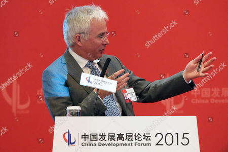 Stock Image of Peter Sands Group Chief Executive of Standard Chartered Plc Attends the Economy Summit of China Development Forum 2015 at Diaoyutai in Beijing City China 21 March 2015 the China Development Forum 2015 is Held in Beijing During 21 to 23 March 2015 with the Theme of China's Economy in the 'New Normal' That Including Economy Summit and Economy Forum China Beijing