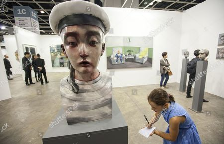 Stock Photo of A Piece Entitled 'Child Sailor' 2013 by Chinese Artist Zhang Xiaogang is Displayed at Art Basel in Hong Kong China 22 May 2013 the Art Fair Hosts 180 Galleries From Around the World and Runs From 22 to 25 May China Hong Kong