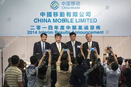 (l-r) the Chief Financial Officer of China Mobile Ltd Xue Taohai the Chairman of China Mobile Ltd Xi Guohua the Chief Executive Officer of China Mobile Ltd Li Yue and the Vice President of China Mobile Ltd Sha Yuejia Pose During a Photocall at the Start of the Company's Interim Results News Conference in Hong Kong China 14 August 2014 China Mobile Ltd the World?s Largest Wireless Network Operator by Number of Subscribers Reported Net Income That Fell 7 8 Percent From a Year Earlier to 32 5 Billion Yuan (5 3 Billion Us Dollar) in the Second Quarter According to Figures Derived From Six-month Results the Beijing-based Company Reported China Hong Kong