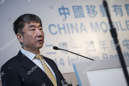 The Chairman of China Mobile Ltd Xi Guohua Speaks During the Company's Interim Results News Conference in Hong Kong China 14 August 2014 China Mobile Ltd the Worlds Largest Wireless Network Operator by Number of Subscribers Reported Net Income That Fell 7 8 Percent From a Year Earlier to 32 5 Billion Yuan (5 3 Billion Us Dollar) in the Second Quarter According to Figures Derived From Six-month Results the Beijing-based Company Reported China Hong Kong