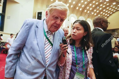 Canadian Nobel Laureate Robert Mundell (l) is Interviewed by a Chinese Journalist As He Tries to Leave the Room During the Nobel Laureates Beijing Forum Held at the Great Hall of the People in Beijing China 10 September 2013 the Theme of This Year's Strategic Forum is 'New Materials and Energy ' Guests of the 2013 Forum Include Nobel Laureates Edmund Phelps George Smoot James Mirrlees Robert Mundell As Well As Four Renowned Scientists China Beijing