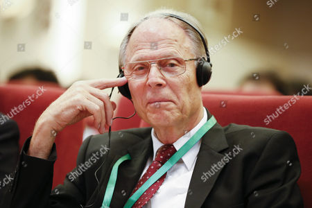 German Md Volker Ter Meulen Listens to a Speech During the Nobel Laureates Beijing Forum Held at the Great Hall of the People in Beijing China 10 September 2013 the Theme of This Year's Strategic Forum is 'New Materials and Energy ' Guests of the 2013 Forum Include Nobel Laureates Edmund Phelps George Smoot James Mirrlees Robert Mundell As Well As Four Renowned Scientists China Beijing