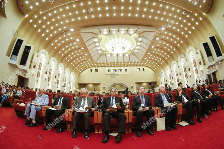 (l-r) a Picture Taken with a Fisheye Lens Shows Canadian Nobel Laureate Robert Mundell Sudanese Professor Mohamed Hassan Brazilian Mathematician Jacob Palis Australian Professor Martin Green Us Nobel Laureate George Smoot British Nobel Laureate James Mirrlees and German Md Volker Ter Meulen During the Nobel Laureates Beijing Forum Held at the Great Hall of the People in Beijing China 10 September 2013 the Theme of This Year's Strategic Forum is 'New Materials and Energy ' Guests of the 2013 Forum Include Nobel Laureates Edmund Phelps George Smoot James Mirrlees Robert Mundell As Well As Four Renowned Scientists China Beijing