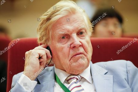 Stock Photo of Canadian Nobel Laureate Robert Mundell Adjusts His Ear Piece During the Nobel Laureates Beijing Forum Held at the Great Hall of the People in Beijing China 10 September 2013 the Theme of This Year's Strategic Forum is 'New Materials and Energy ' Guests of the 2013 Forum Include Nobel Laureates Edmund Phelps George Smoot James Mirrlees Robert Mundell As Well As Four Renowned Scientists China Beijing