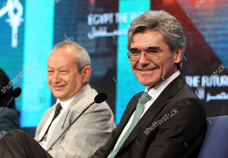 Joe Kaeser (r) Ceo of German Industrial Group Siemens and Egyptian Businessman Naguib Sawiris (l) During the Second Day of the Egypt Economic Development Conference (eedc) in the Red Sea Resort of Sharm El-sheikh Egypt 14 March 2015 Global Business Executives and Government Officials Attend the Egypt Economic Development Conference in the Resort Town of Sharm Al-sheikh Egypt Sharm Elsheikh