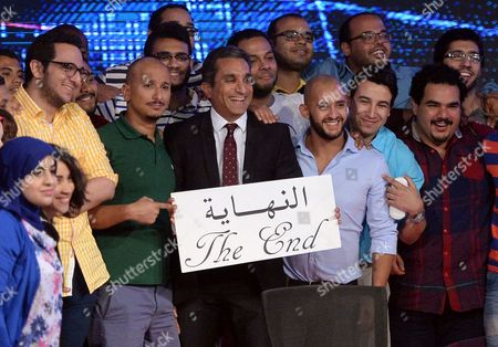 Egypt's Popular Satirist Bassem Youssef (c) Poses For a Photo with the Crew of His Show 'Al-bernameg' After Announcing It Will not Be Returning to Television in Cairo Egypt 02 June 2014 Youssef Said on 02 June That His Show Will not Be Returning to Television Youssef's Program Al-bernameg Which Means the Show was Broadcast on the Saudi-funded Mbc Network the Show Had Taken a One-month Vacation and Had Been Scheduled to Return on 30 May Two Days After the Presidential Election Ended However It was Suspended Egypt Cairo