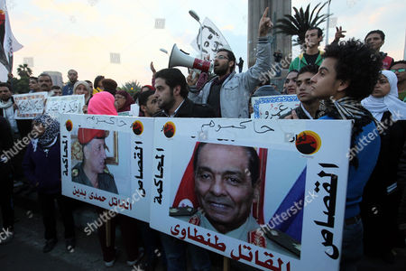 Egyptian Protesters Hold a Banner with Photo Depicting the Former Head of the Military Council Mohamed Hussein Tantawi (r) and Arabic Inscription Reading 'Retribution' During a March to Mark the Second Anniversary of the Cabinet Clashes in Central Cairo Egypt 16 December 2013 Media Reports State That Activists Called For a March to the Cabinet Headquarters to Mark the Second Anniversary of Clashes at the Site That Left 18 People Killed Egypt Cairo