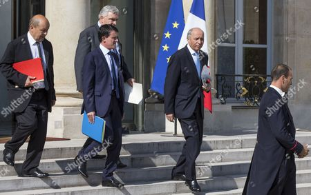 (l-r) French Defense Minister Jean-yves Le Drian Junior Minister in Charge of Transports Sea and Fishing Frederic Cuvillier French Prime Minister Manuel Valls and French Foreign Affairs Minister Laurent Fabius Leave the Elysee Palace After an Extraordinary Cabinet Meeting in Paris France 25 July 2014 the Cabinet Meeting Took Place Under the Shadow of the Disappearence of the Air Algeria Flight Ah5017 the Day Before with 51 French Passengers on Board No Survivors Were Found the Wreckage of an Air Algerie Plane with 116 People on Board That Disappeared From Radar During a Storm Has Been Found in Eastern Mali the Malian Government Confirmed France Paris