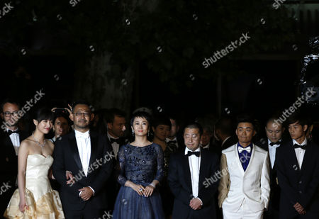 (l-r) Chinese Actress Meng Li Chinese Actor Jiang Wu Chinese Actress Tao Zhao Chinese Director Jia Zhangke Chinese Actor Baoqiang Wang and Chinese Actor Lanshan Luo Arrive For the Screening of 'Tian Zhu Ding' (a Touch of Sin) During the 66th Annual Cannes Film Festival in Cannes France 17 May 2013 the Movie is Presented in the Official Competition of the Festival Which Runs From 15 to 26 May France Cannes