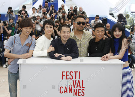 (l-r) Chinese Actor Lanshan Luo Chinese Actress Tao Zhao Chinese Director Jia Zhangke Chinese Actor Jiang Wu Chinese Actor Baoqiang Wang and Chinese Actress Meng Li Pose During the Photocall For 'Tian Zhu Ding' (a Touch of Sin) at the 66th Annual Cannes Film Festival in Cannes France 17 May 2013 the Movie is Presented in the Official Competition of the Festival Which Runs From 15 to 26 May France Cannes