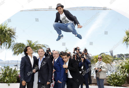 French Actor Jamel Debbouze (up) Jumps As (l-r) French Actor Tewfik Jallab Moroccan Director Mohamed Hamidi Actor Fatsah Bouyahmed and French Actor Malik Bentalha Look on During the Photocall For 'Ne Quelque Part' at the 66th Annual Cannes Film Festival in Cannes France 21 May 2013 the Movie is Presented in the Special Screenings Section of the Festival Which Runs From 15 to 26 May France Cannes