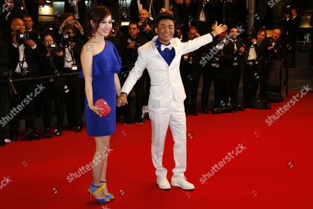 Chinese Actor Baoqiang Wang (r) and His Wife Ma Rong (l) Arrive For the Screening of 'Tian Zhu Ding' (a Touch of Sin) During the 66th Annual Cannes Film Festival in Cannes France 17 May 2013 the Movie is Presented in the Official Competition of the Festival Which Runs From 15 to 26 May France Cannes