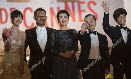 (l-r) Chinese Actress Meng Li Chinese Actor Jiang Wu Chinese Actress Tao Zhao Chinese Director Jia Zhangke and Chinese Actor Lanshan Luo Arrive For the Screening of 'Tian Zhu Ding' (a Touch of Sin) During the 66th Annual Cannes Film Festival in Cannes France 17 May 2013 the Movie is Presented in the Official Competition of the Festival Which Runs From 15 to 26 May France Cannes