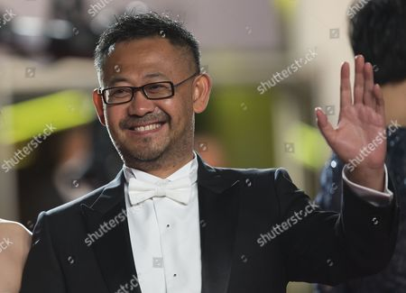 Stock Image of Chinese Actor Jiang Wu Arrives For the Screening of 'Tian Zhu Ding' (a Touch of Sin) During the 66th Annual Cannes Film Festival in Cannes France 17 May 2013 the Movie is Presented in the Official Competition of the Festival Which Runs From 15 to 26 May France Cannes