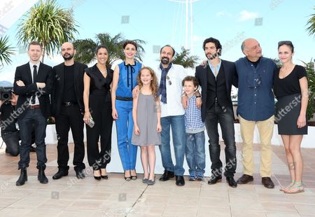 (l-r) French Producer Alexandre Mallet-guy Iranian Actor Ali Mosaffa French Actress Sabrina Ouazani French Actress Berenice Bejo Actress Jeanne Jestin Iranian Director Asghar Farhadi Actor Elyes Aguis French Actor Tahar Rahim and Belgian Actress Pauline Burlet Pose During the Photocall For 'Le Passe' (the Past) at the 66th Annual Cannes Film Festival in Cannes France 17 May 2013 the Movie is Presented in the Official Competition of the Festival Which Runs From 15 to 26 May France Cannes