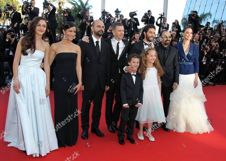(l-r) Belgian Actress Pauline Burlet French Actress Sabrina Ouazani Iranian Actor Ali Mosaffa French Producer Alexandre Mallet-guy Actor Elyes Aguis Actress Jeanne Jestin French Actor Tahar Rahim Iranian Director Asghar Farhadi and French Actress Berenice Bejo Arrive For the Screening of 'Le Passe' (the Past) During the 66th Annual Cannes Film Festival in Cannes France 17 May 2013 the Movie is Presented in the Official Competition of the Festival Which Runs From 15 to 26 May France Cannes