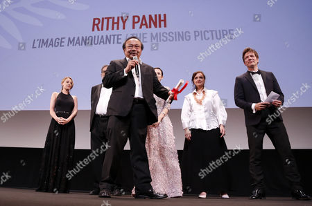 Cambodian Director Rithy Panh (front C) Receives the 'Un Certain Regard' Award For His Movie 'The Missing Picture' From Jury Members (rear L-r) Ludivine Sagnier Enrique Gonzalez Macho Zhang Ziyi Ilda Santiago and Thomas Vinterberg During the 'Un Certain Regard' Closing Ceremony As Part of the 66th Annual Cannes Film Festival in Cannes France 25 May 2013 France Cannes